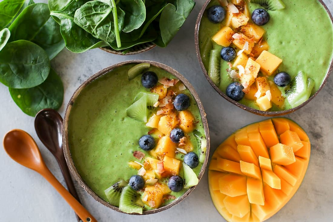green smoothie in coconut bowl